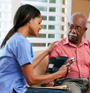 nurse checking a senior man